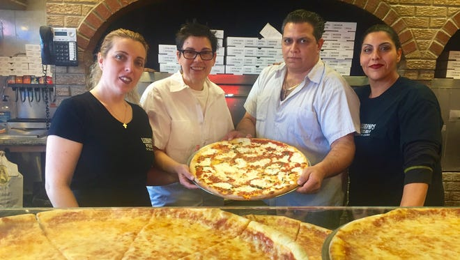 The Lubrano family has been making pizza for their entire lives. Pictured are Isabella Elbana, Angie Lubrano, Joe Lubrano and Lucia Furnari.
