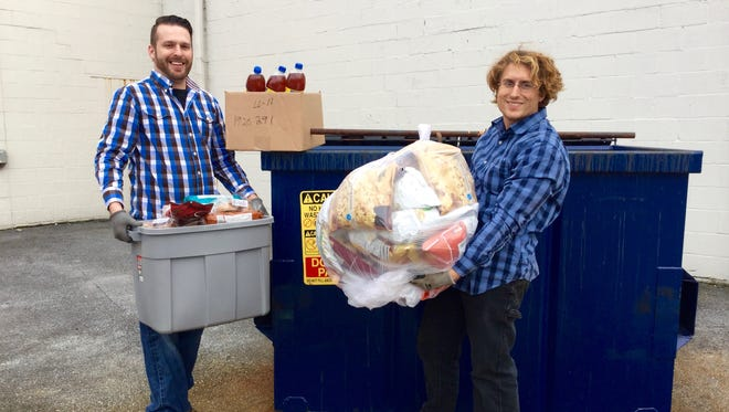 Tony Moyer, left, and Sam Troyer, right, dumpster dive at a CVS in Lebanon.