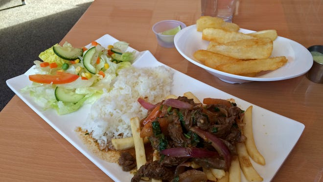 The Saltado Beef lunch combo at Pisco Peruvian Cuisine in Cedar City is served with French fries, garlic white rice and a side salad.