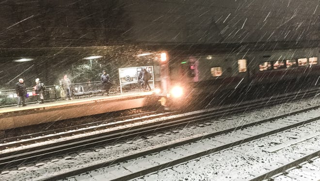 Snow falls as the 5:06 a.m. train to Grand Central pulls in to Mamaroneck.