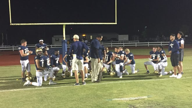 Holy Trinity players gather after their 49-6 spring football game win over West Oaks Academy.