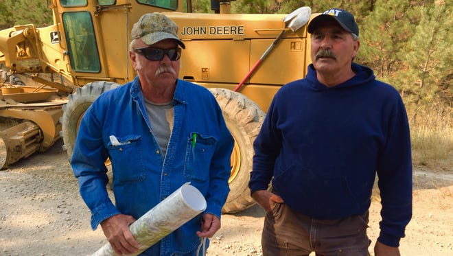 Jim Beck, left, and Patrick Racicot say Dearborn River Road is in bad need of repair.