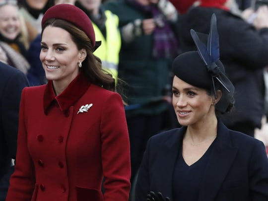 In this Dec. 25, 2018, file photo, Britain's Kate, Duchess of Cambridge, left, and Meghan, Duchess of Sussex, arrive to attend the Christmas day service at St Mary Magdalene Church in Sandringham in Norfolk, England. The British press on Jan. 29, 2019, is urging social media users to tone down inappropriate criticism of the duchesses.