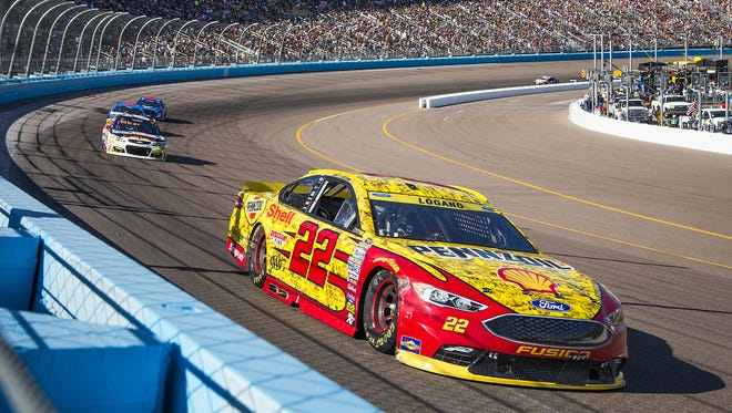 Joey Logano takes turn one during the Can-Am 500 NASCAR Sprint Cup Series race at Phoenix International Raceway Sunday afternoon, November 13, 2016. Logano won the race.