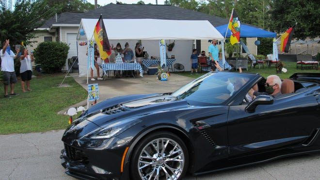 Flagler County Corvette Club members wave at Annelise Guffey during her 80th birthday driveby celebration on July 17.