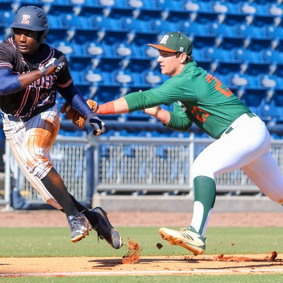 Escambia's Frank Peasant (24) gets tagged out by Mosley's