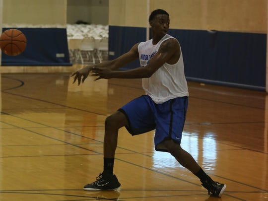 MTSU forward Karl Gamble makes a pass during the Blue