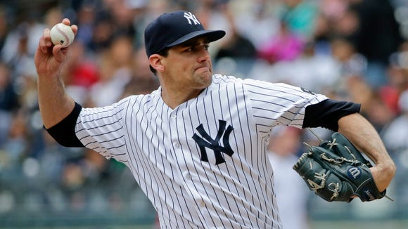 New York Yankees' Nathan Eovaldi delivers a pitch during the first inning of a baseball game against the Boston Red Sox Saturday, May 7, 2016, in New York.