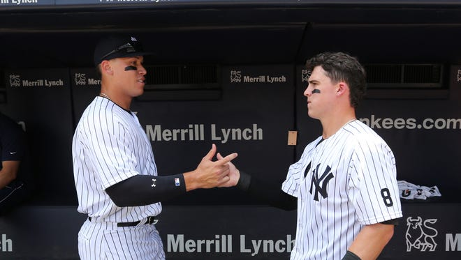 New York Yankees' Aaron Judge, left, and Tyler Austin greet each other in the dugout before their baseball game against the Tampa Bay Rays Saturday, Aug.13, 2016, at Yankee Stadium in New York.