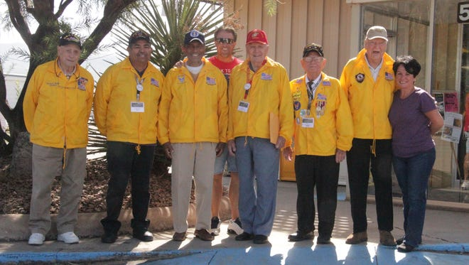 Six of the eight Otero County 2015 Honor Flight participants and two volunteers gathered at the Alamogordo Daily News office Saturday to talk about their experience. Pictured form left to right are Delmar Sanders (WWII and Korea), Hector Dominguez (Vietnam), Monroe Ratchford (Korea and Vietnam), Dave Lindley, Fred Ballek (WWII, Korea and Vietnam), Bill Murphy (WWII, Korea and Vietnam), Robert Blount (WWII, Korea and Vietnam) and Rocky Galissini, an Honor Flight volunteer guardian.