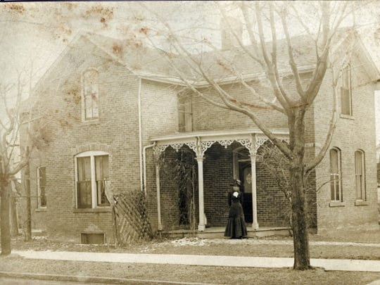 Daisy Thomas stands in front of her house at 89 Wood