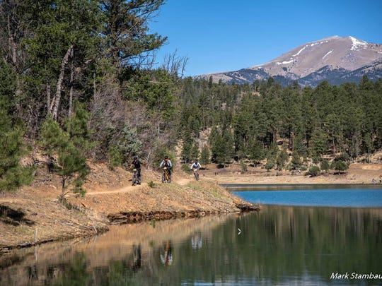 The laps may be tough, but the ecenery is easy on the tyes around Grindstone Lake as part of the 12 Hours in the Wild West mountain bike tournament in Ruidoso.
