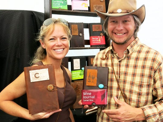 "Tawnya Parker and Trevor Washko, of Aspen, Colo.,   show off  Cold Mountain Craft work embellish with ""tattoo patches"" at the Vail Farmers' Market & Art  Show."