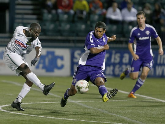 Rhinos midfielder Kenardo Forbes, shown in a match