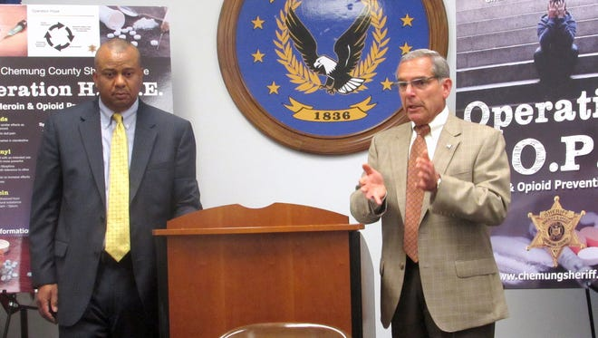 Chemung County Executive Tom Santulli, right, and Sheriff Christopher Moss talk Wednesday about a new program to battle opioid abuse in the county.