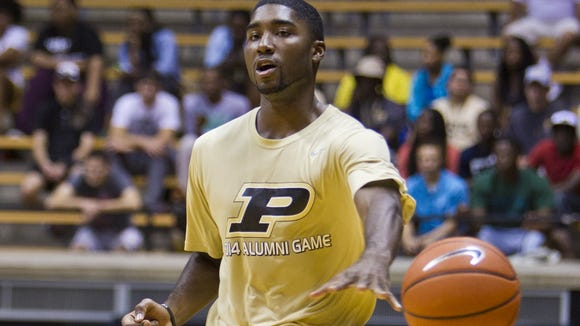 Purdue alumnus E'Twaun Moore passes the ball at the alumni basketball game Saturday, August 2, 2014, at Mackey Arena in West Lafayette.