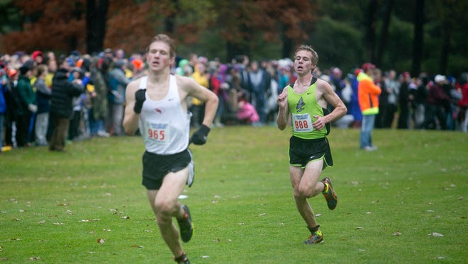 D.C. Everest's Anthony Anderson, right, trails Middleton's Gus Newcomb during the Division 1 boys race at the 2015 State Cross Country Championships at the Ridges Country Club in Wisconsin Rapids, Saturday, Oct. 31, 2015.
