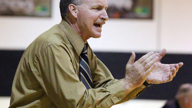 Pendleton High School girls basketball head coach Tim Wood encourages his players from the bend in the third quarter.