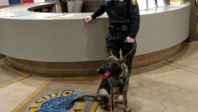 Livonia police officer Matt McWilliams with Riley, the newest K-9 officer with the LPD.