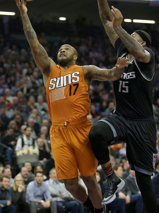 Phoenix Suns forward P.J. Tucker, left, goes to the basket against Sacramento Kings forward DeMarcus Cousins during the first quarter of an NBA basketball game Friday, Feb. 3, 2017, in Sacramento, Calif. (AP Photo/Rich Pedroncelli)