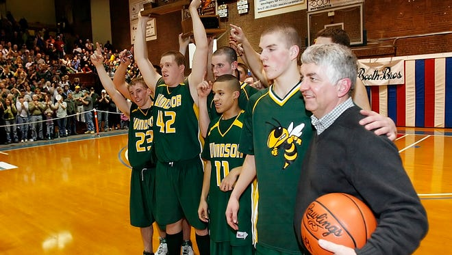 Coach Harry Ladue, right, poses with his players following Windsor's 2008 high school boys basketball championship win at Barre Auditorium. Monday, Ladue secured his 400th win, joining an elite group of Vermont coaches.