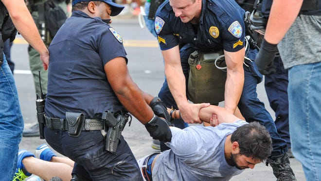 Protesters being arrested by police.  July 10, 2016