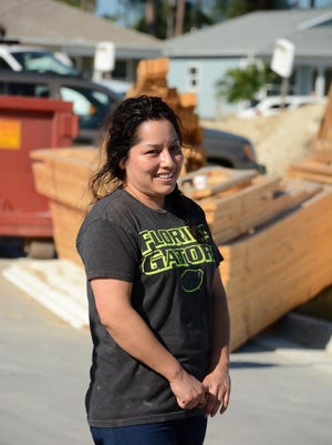 Soon-to-be homeowner Martha Morales speaks to the group. Volunteers from Arthrex swarmed over the Legacy Lakes community Saturday morning, working to help their coworker Martha Morales earn a house through Habitat for Humanity.