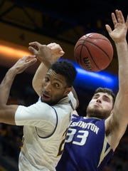 California's Marcus Lee, left, and Washington's Sam Timmins (33) vie for a rebound during the first half of an NCAA college basketball game, Saturday, Feb. 24, 2018, in Berkeley, Calif. (AP Photo/D. Ross Cameron)