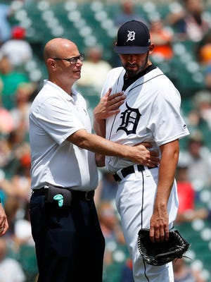 Tigers pitcher Ryan Carpenter, right, is looked at by trainer Matt Rankin in the fifth inning on Thursday, May 31, 2018, at Comerica Park. Carpenter left the game.