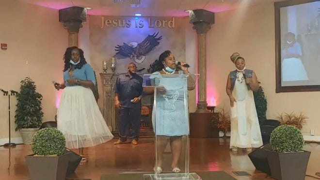 During the service that was broadcast live via Facebook, four members from the Showers of Blessings Harvest Center Praise Team lead the praise and worship part of the Sunday morning worship service.