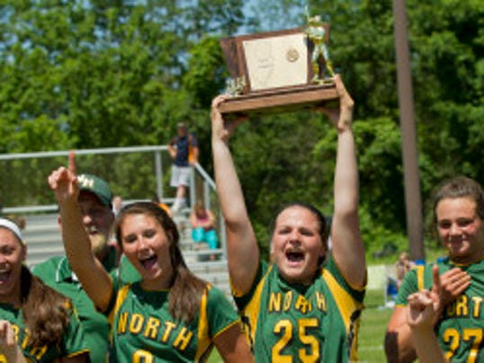 Senior Kayla Parker hosts the championship trophy as North Hunterdon celebrates its Group IV state championship