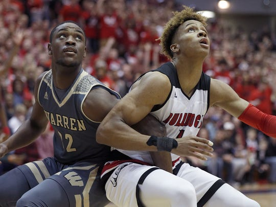 New Albany Bulldogs Romeo Langford (1) and Warren Central Warriors David Bell (22) fight for position in the first half of their IHSAA Boys 4A Semi-State basketball game at the Lloyd E.Scott Gym in Seymour IN.,  on Saturday, March 16, 2018.