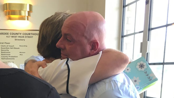 Dan Jenkins is comforted by family members after delivering emotional testimony in the trial of Michael Phillips in Hardee County on Tuesday, Aug. 22, 2017. Phillips is accused of driving under the influence of drugs, killing Jenkins' wife, Jennifer, and her friend Kathleen O'Callaghan, both of Naples.