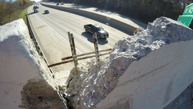 The overpass wall on the south side of Flint Road crossing I-96, shown Wednesday, Nov. 8, 2017, has crumbled, and one resident is deeply concerned that chunks of concrete could drop onto the freeway.
