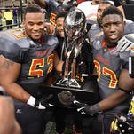 Grambling players hoist up the Bayou Classic trophy on Saturday after beating Southern in New Orleans.