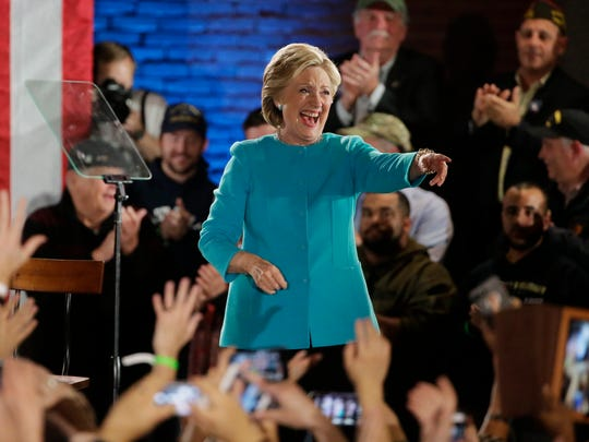 Hillary Clinton takes the stage during a campaign rally