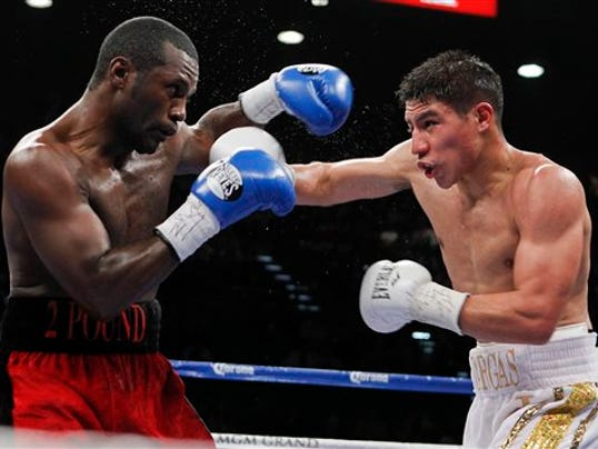 FILE - In this May 5, 2012, file photo, Boxers Jessie Vargas, right, and Steve Forbes exchanges punches  during a welterweight fight in Las Vegas.  Timothy Bradley started his boxing career with 31 straight victories before the former two-division champion went 0-1-1 in his last two fights. He looks to get back on a winning track Saturday, June 27, 2015, against the unbeaten Vargas.(AP Photo/Isaac Brekken, File)