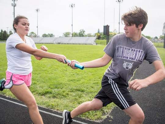 Kemory Rhoades hands off the relay baton during practice