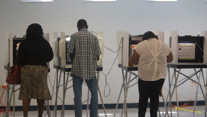 Residents cast their ballots for primary elections at the Jack L. McLean Jr. Community Center on Tuesday.
