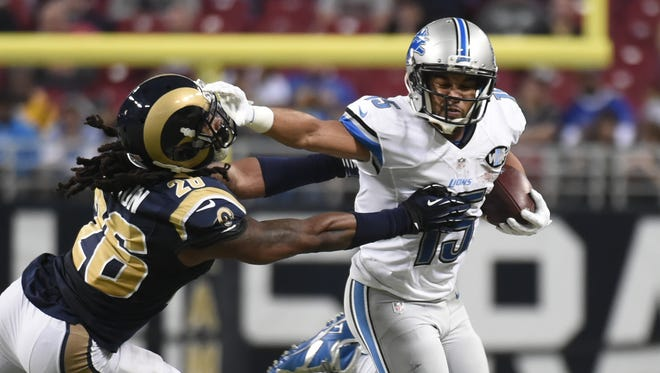 Lions receiver Golden Tate runs for a 15-yard gain against the St. Louis Rams on Dec. 13, 2015, in St. Louis.
