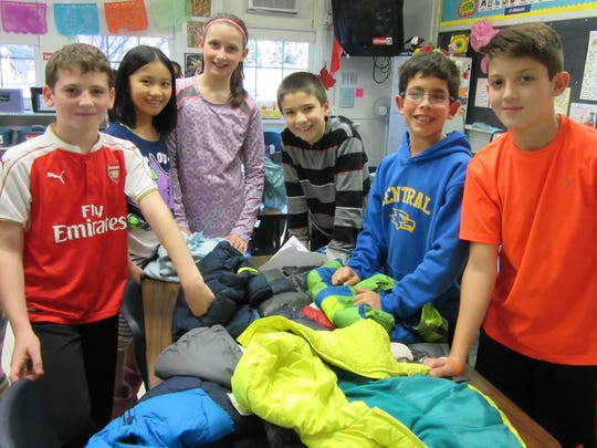 Central 5th grade peer leaders collected more than 100 coats. From left,  Noah Paradise, Cynthia Ming, Anne Brueger, John Doucette, Jacob Meltzer, James Burke.