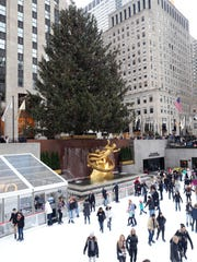 Skaters enjoy the ice at Rockefeller Center in New York, in front of the Christmas tree, Dec. 3, 2017.