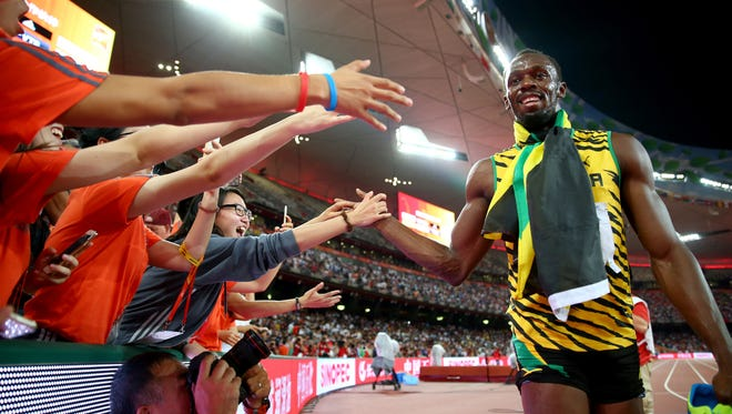 Usain Bolt of Jamaica celebrates after crossing the finish line to win gold in the Men's 200 metres final during day six of the 15th IAAF World Athletics Championships Beijing 2015 at Beijing National Stadium on August 27, 2015 in Beijing, China.