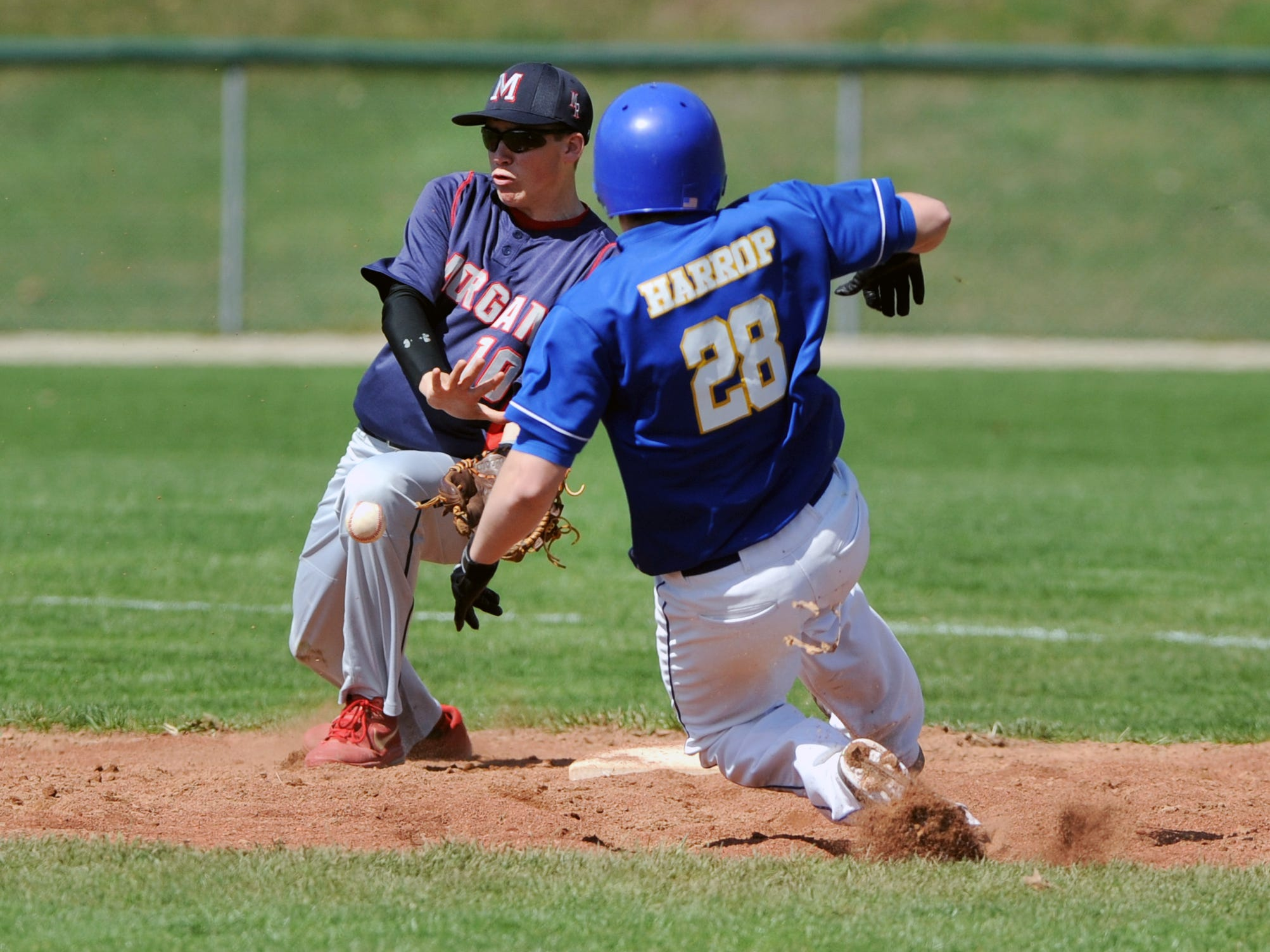 Philo's Wyatt Harrop slides safely into second base before Morgan's Tyler Hook can apply the tag during a game Saturday at Duncan Falls.