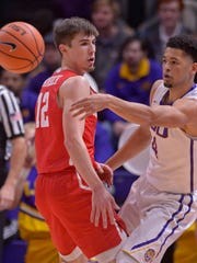 LSU guard Skylar Mays (4) passes around Houston guard Wes VanBeck (12),  during an NCAA college basketball game Wednesday, Dec. 13, 2017, in Baton Rouge, La. (Hilary Scheinuk/The Advocate via AP)