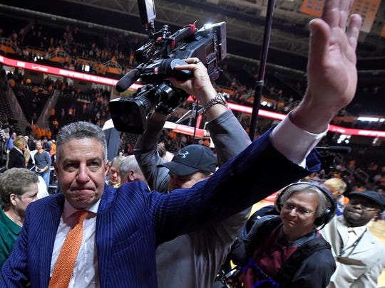 Auburn head coach Bruce Pearl waves goodbye to supportive fans while leaving the court following Auburn's 71-63 loss to Tennessee in an NCAA college basketball game at Thompson-Boling Arena in Knoxville, Tenn. on Saturday, Jan. 31, 2015. (AP Photo/Knoxville News Sentinel, Adam Lau)