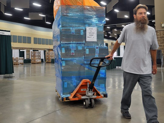David Jordan hauls in one of many pallets of merchandise for the Sun and Ski company at the 37th Annual Hotter 'N Hell Hundred Consumer Show which opens Thursday afternoon.