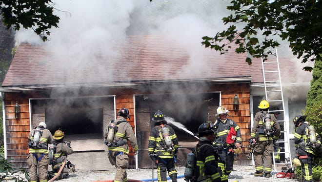 Patterson firefighters, with help from Putnam Lake, Lake Carmel and Pawling firefighters, work at the scene of a fire that destroyed a 2-car garage at 282 Cushman Road in Patterson Aug. 16, 2014.