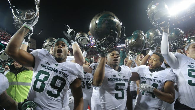 Michigan State celebrates the 17-14 win against Ohio State on Nov. 21 at Ohio Stadium.