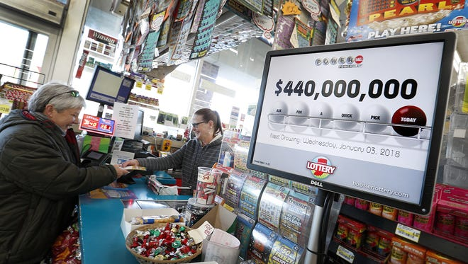 The lottery machines were busy at Bucks Super Market with people buying lottery tickets Tuesday, Jan 2, 2018. Mega Millions is up to $340 million, with a Tuesday drawing, and the Powerball $440 million with the drawing on Wednesday.